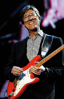 Hank Marvin with a fiesta red Strat (here a later reissue)