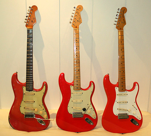 Original fiesta red (left), the refinished Strat in the middle is similar to hot rod red, the fiesta red Squier (right) is more towards an orange-red