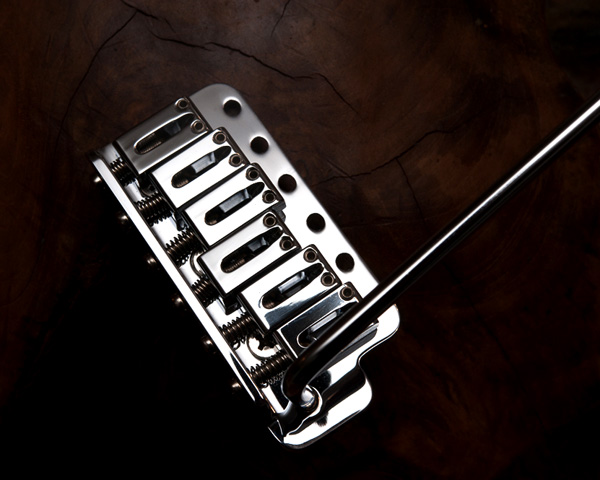 The chrome-plated tremolos on Schecter Dream Machine Strats were also of brass