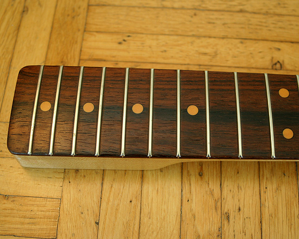 I wonder if the fingerboard of the Schecter neck is Brazilian rosewood or Cocobolo. This info must be in the neck code which says F773S but this code is not included in the (older) Schecter catalogue I have.