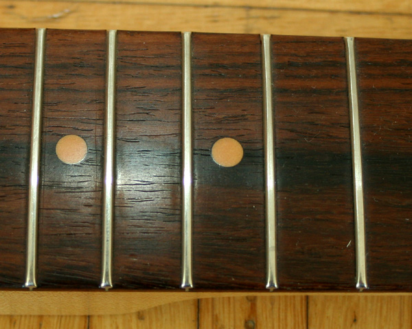 Those grains indicate a South American rosewood, and the wood has a typical oily shine. Cocobola is often lighter than Braz rosewood but the latter can vary to a large extend.