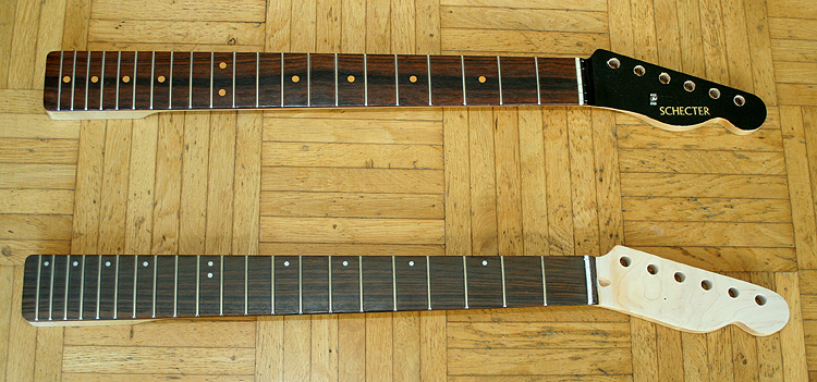 Both necks - note the different colour of the rosewood fingerboards